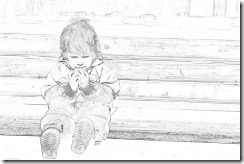 lonely child sits on a bench